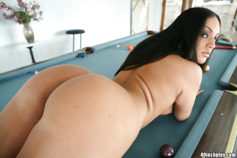 Big ass brunette in fishnet stockings spreading her legs wide open