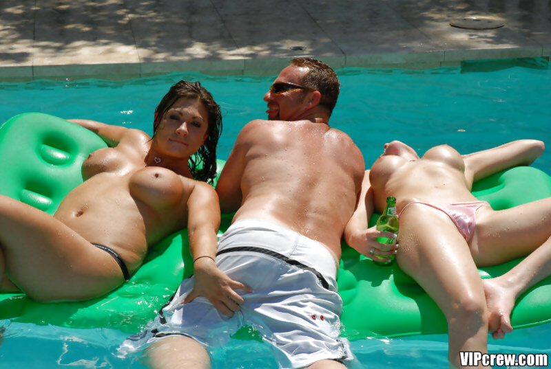Busty babes are swimming in the pool and getting drilled