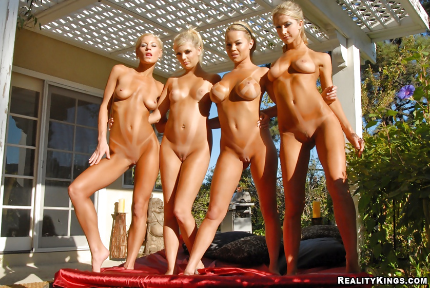 Four adorable ladies are enjoying passionate sex outdoor