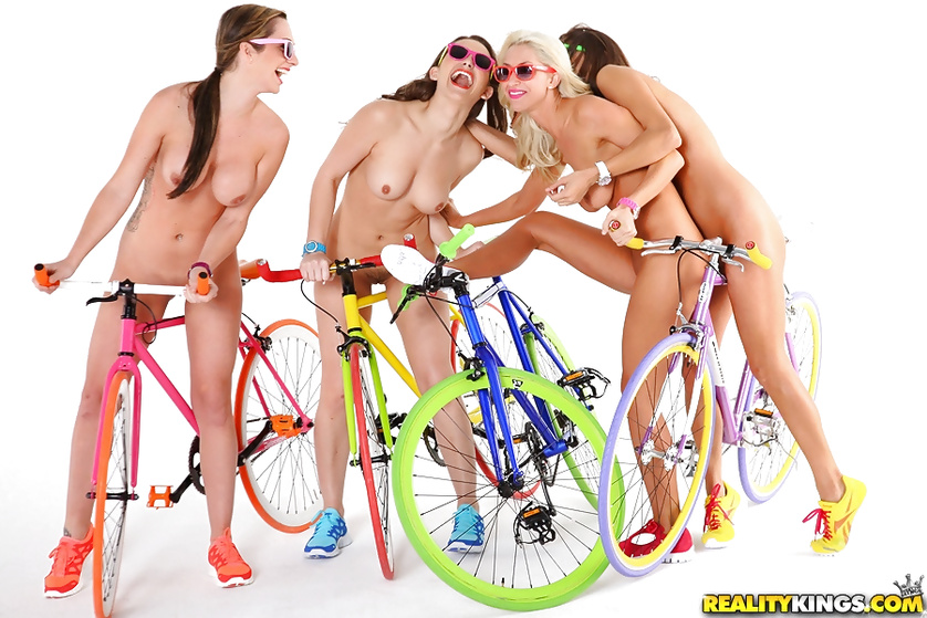 Tender babes are riding colorful bicycles and fucking wildly