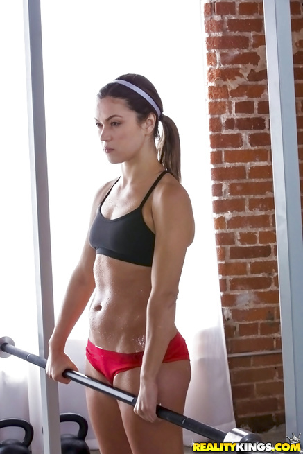 Two gorgeous sport babes are fucking wildly in the gym