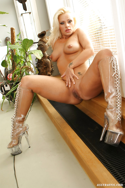 Juicy blonde in white fishnet is riding strong cock