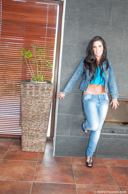Big tits brunette is covered in denim almost head to toe, has naughty fun on cam