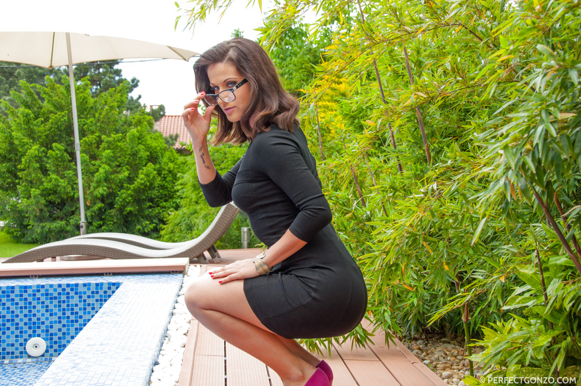 Spectacled and spectacular brunette posing in a pool, fucking outside of it