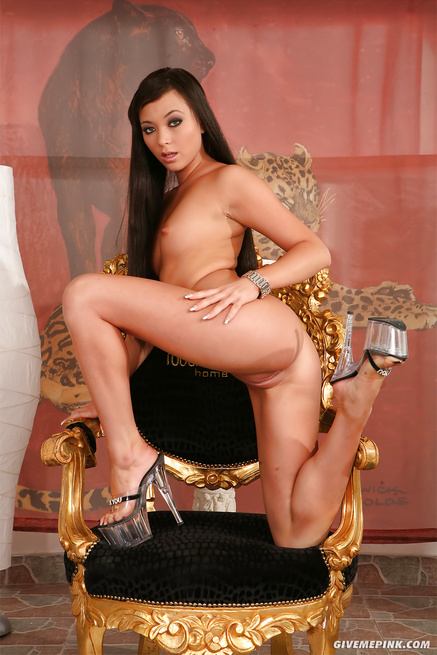 Juicy brunette is having solo on the golden chair