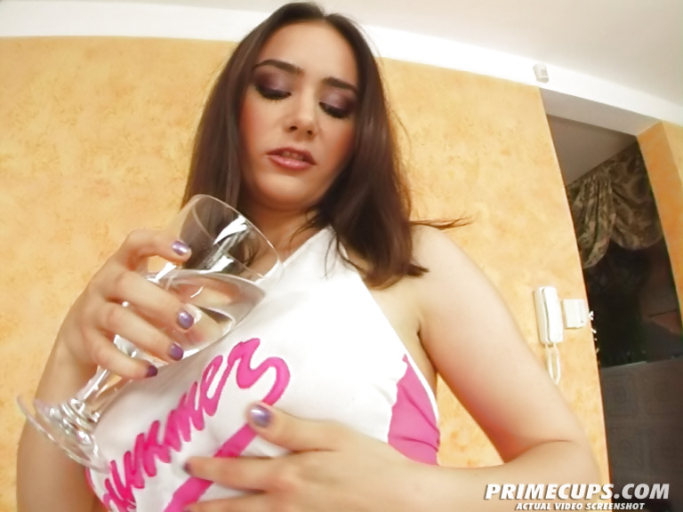 Young brunette in pink stockings loves dildoing her pussy