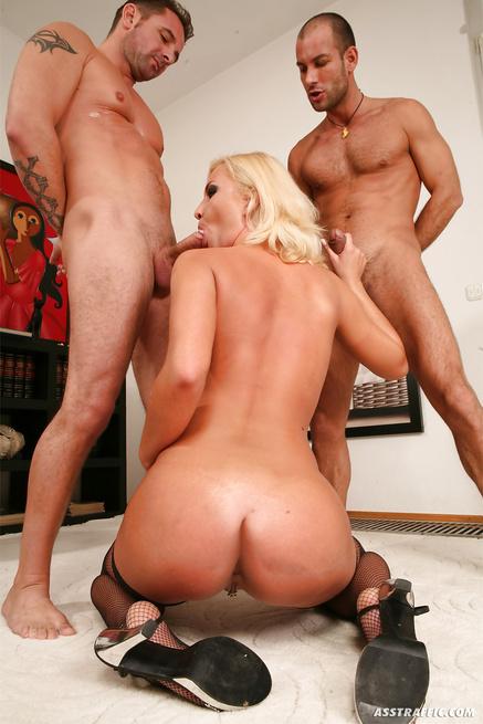Gorgeous blonde in black stockings is enjoying wild threesome
