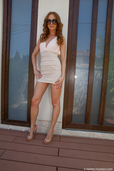 Redhead babe loves drilling her ass with glass dildo
