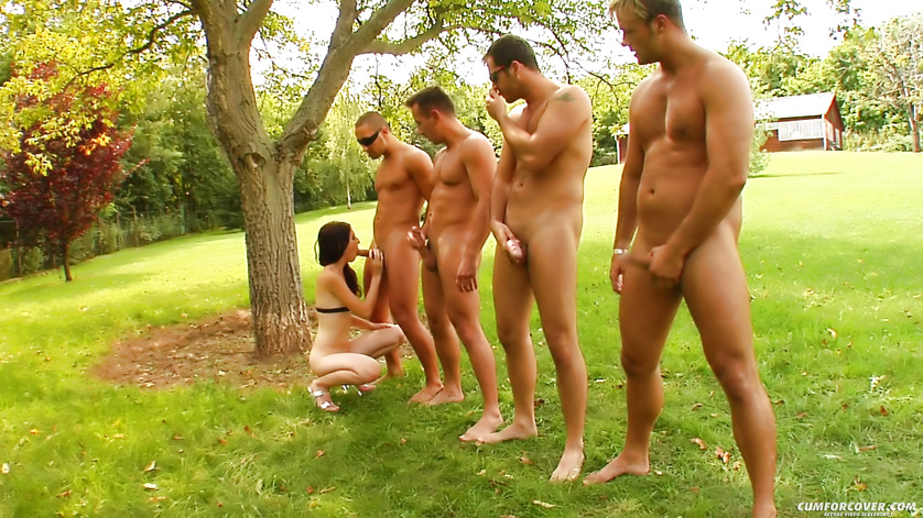 Unforgettable blowbang sex with brunette under the tree