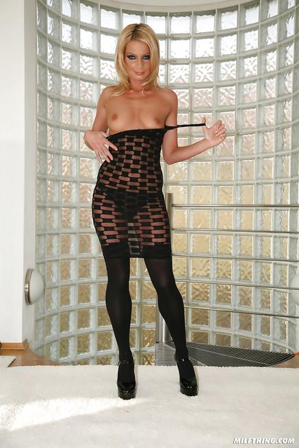 Satisfying lovely blonde MILF wearing black stockings