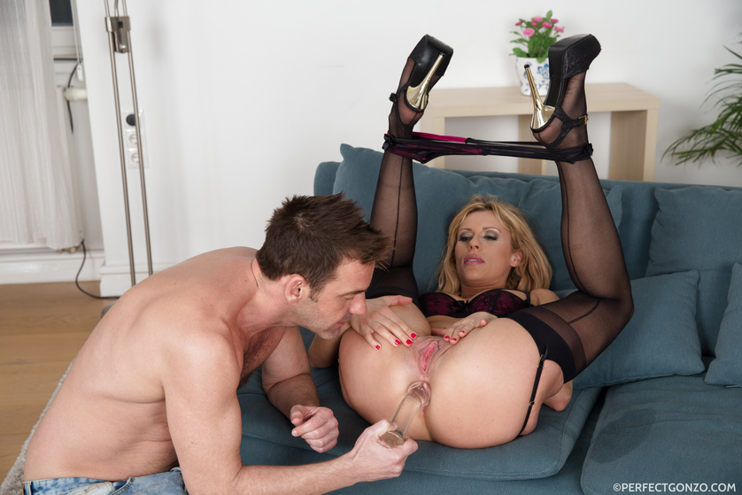 Lovely MILF gets drilled with dildo and her man's cock