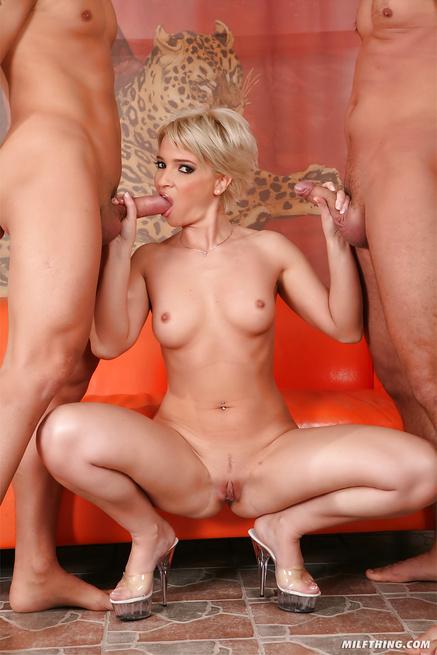 Horny MILF is enjoying threesome on the orange sofa