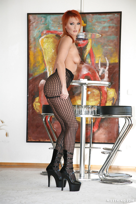 Juicy redhead lady is being punished with great energy