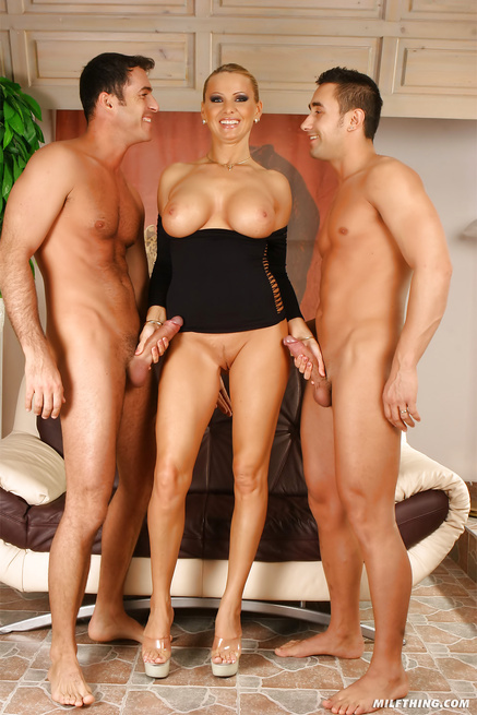 Adorable MILF is presenting handsome guys with wild sex