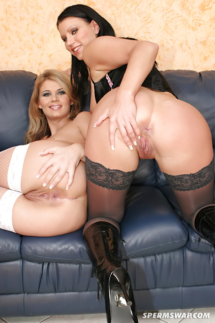 Babes in white and black stockings are sharing cock