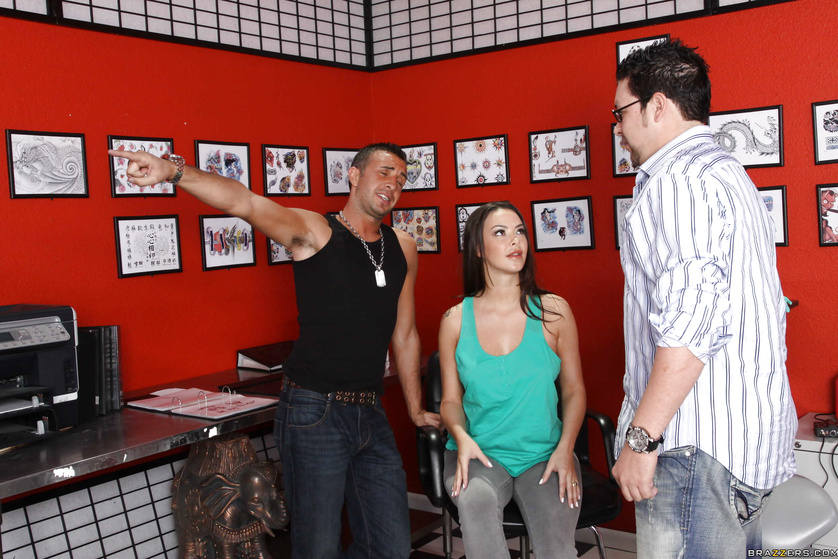 Tatted-up slut Sophia Santi gets fucked in a tattoo parlor