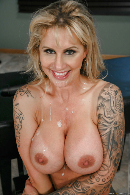 Science can't improve this tatted-up blonde with fake tits