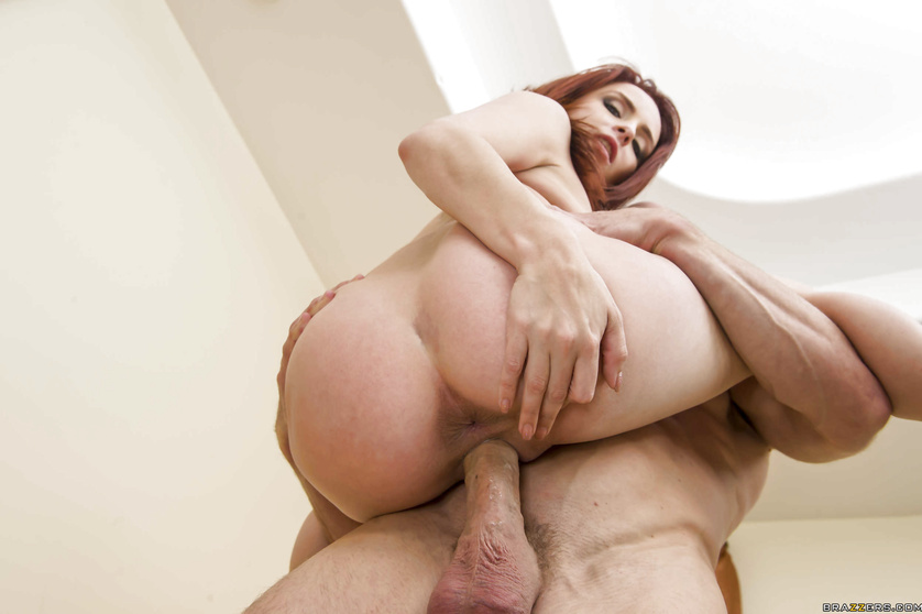 Redhead flashes her tits and lets the guy go wild all over her pussy