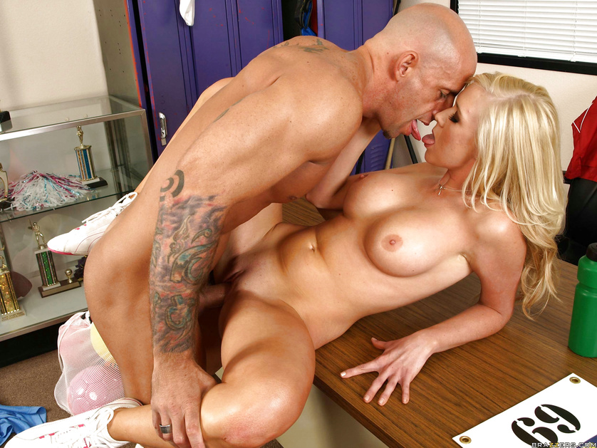 Juicy blonde is riding the bald man's cock on the big table