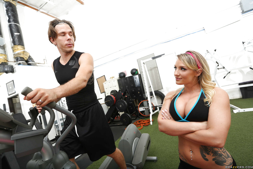 Juicy blonde is playing with her coach's big cock in the gym