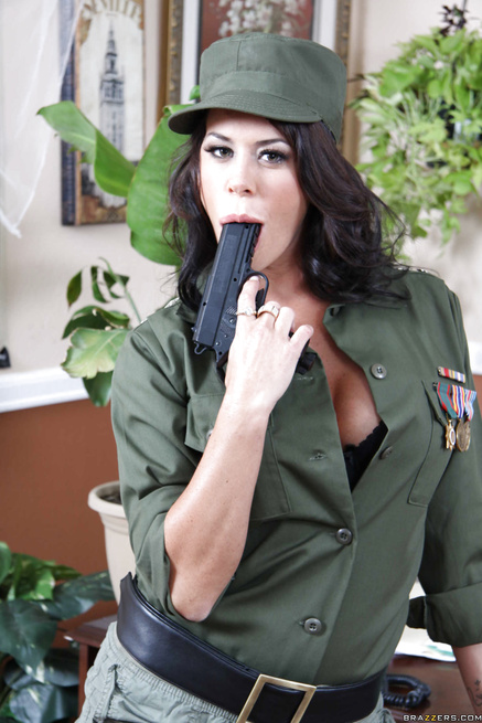 Hot brunette is holding the gun and fucking with the army man