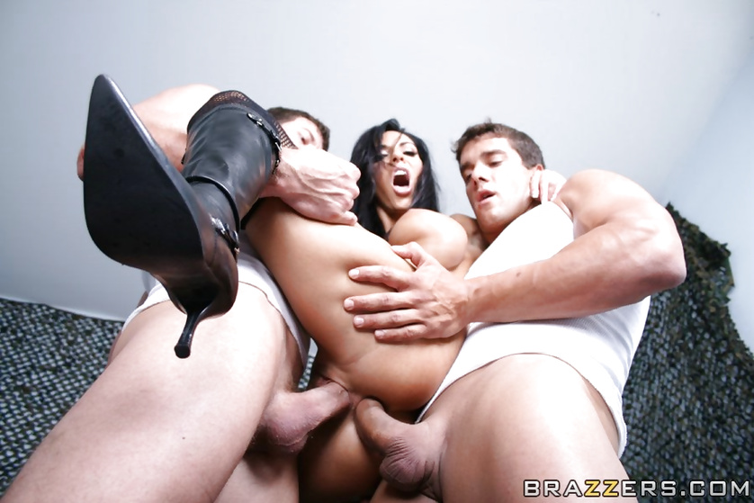 Dirty brunette is being fucked by two strong army men