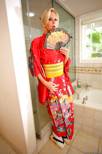 Busty blonde in Asian uniform is fucking with her man in the shower