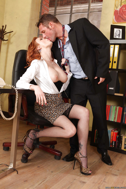 Glasses-wearing redhead MILF fucked while talking on the phone