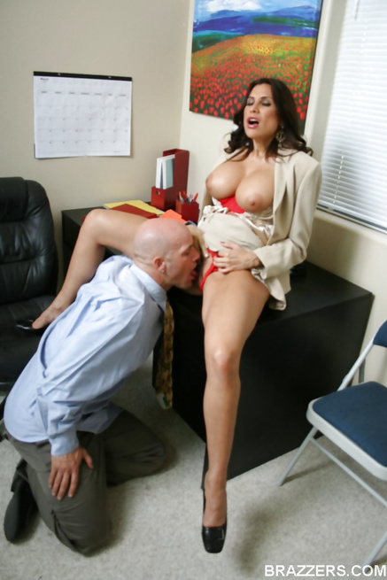 Brunette MILF showing off her tits while talking to her coworker