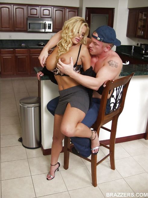 Buxom blonde MILF gets seduced in the kitchen by a hung guy