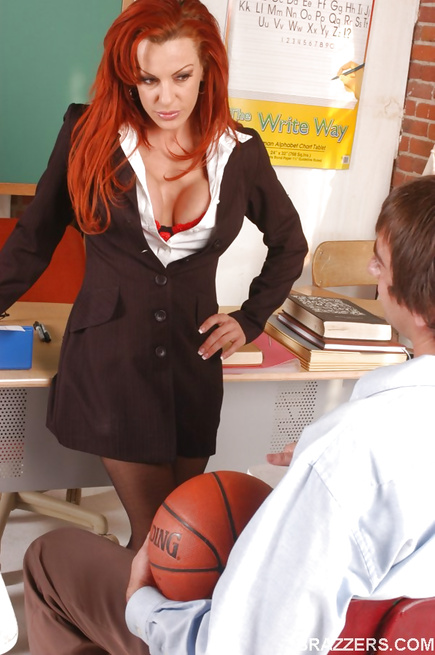 Redhead dressed in red gets her holes destroyed on a desk