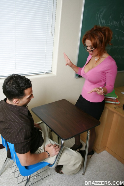 Naughty redheaded teacher flashes her tits and fucks a student