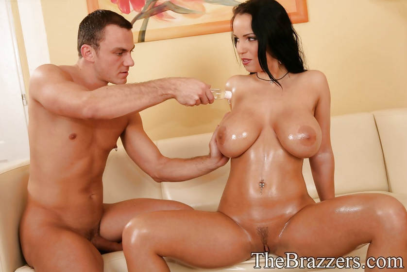 Oiled pornstar is playing with the dildo and getting banged hard