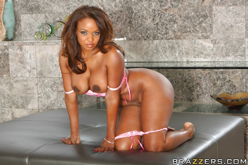 Ebony woman is masturbating and being fucked into her ass