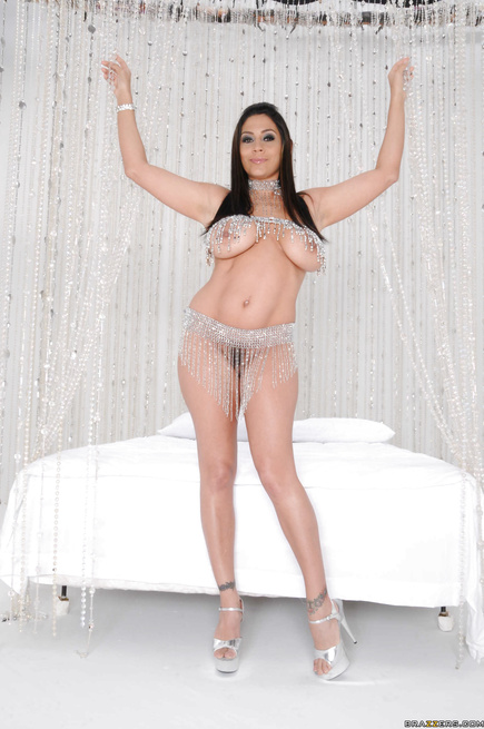 Chubby brunette in silver shoes is being fucked in the white bed