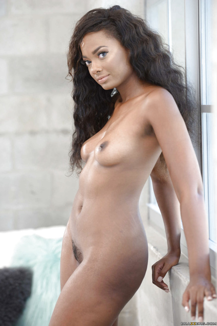 Ebony brunette with long curly hair is enjoying interracial sex