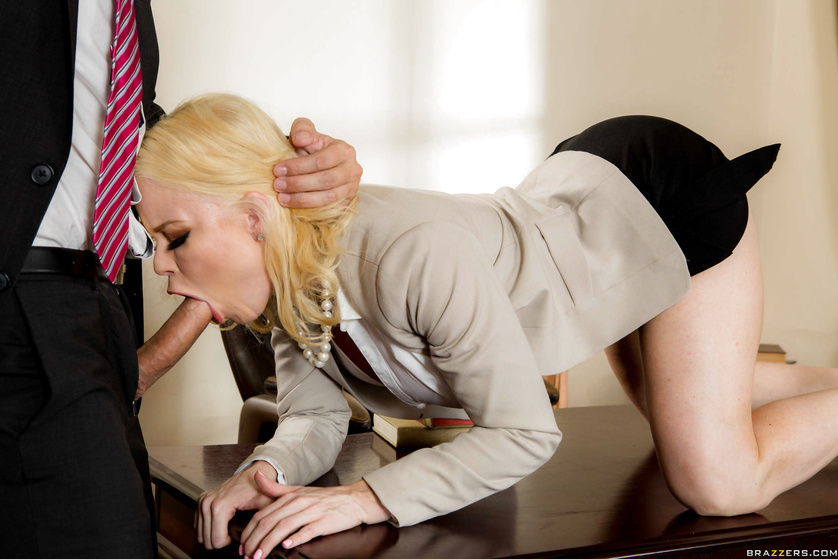 Pouty blonde gets on all fours for a sloppy blowjob at the office