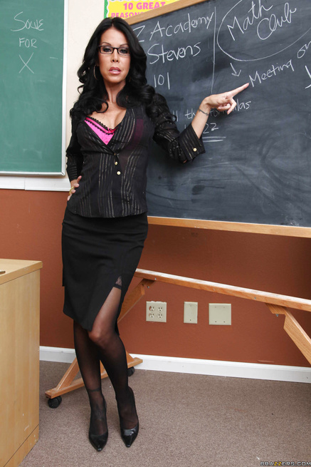 Strict-looking teacher hottie uses her ruler to measure a cock