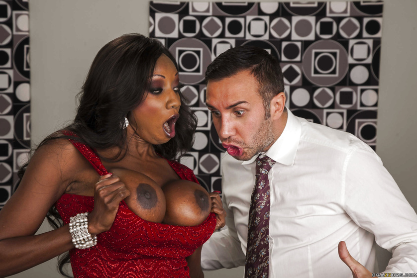 Ebony boss MILF shows her massive mocha knockers to her underling