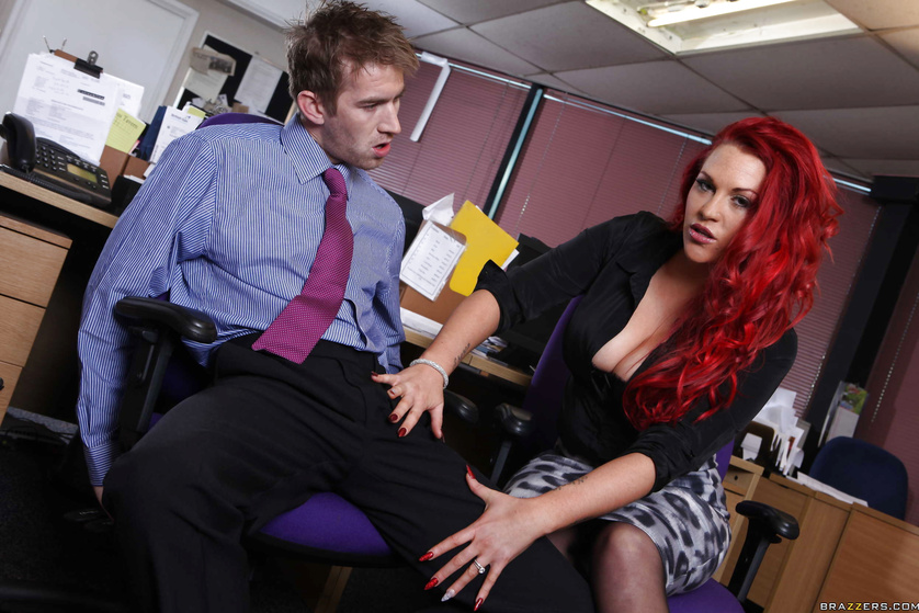 Delightful redhead has her tight pussy stretched out at work