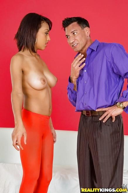 Big-tittied model in orange leggings is getting penetrated deep