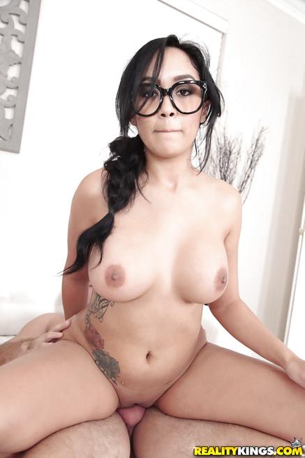 Beautiful Latina madam wearing glasses is getting penetrated deep