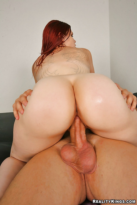 Redhead babe having natural tits is riding her lover's penis