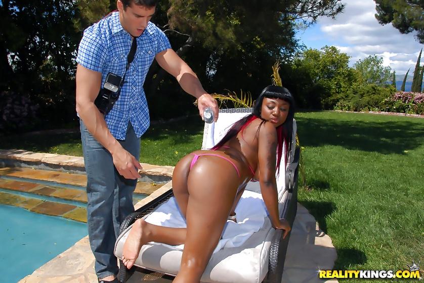 Chocolate queen having big tits is fucking wildly outdoor