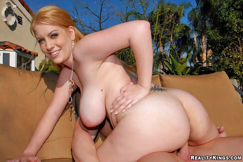 Juicy blonde having cool tattoo is getting penetrated outdoor
