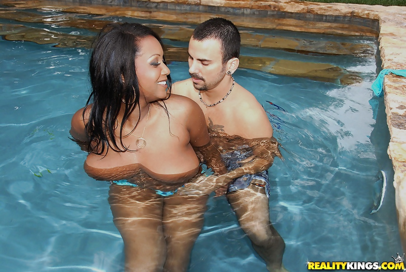Horny white man is having interracial sex with ebony babe in the pool