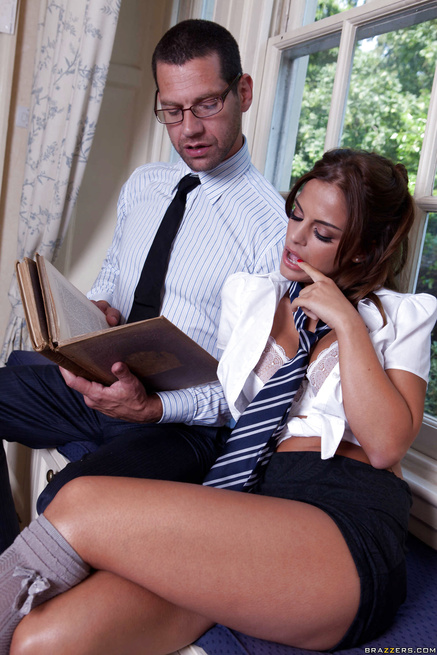 Tanned brunette seduces her serious-looking tutor with her tits