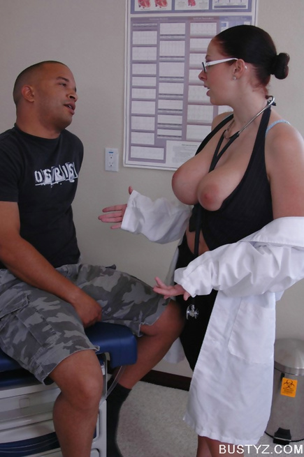 Thick brunette doctor flashes her massive knockers at first