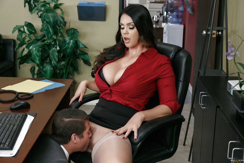 Busty office slut spreading her legs and getting licked under the table