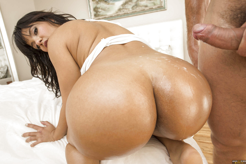 Oily and exotic brunette shows her amazing booty before the scene